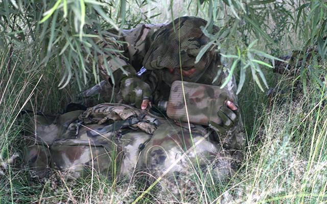 An operator in rural camoflague